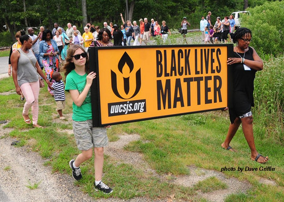 Installing our Black Lives Matter sign August 23, 2015